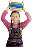 Schoolgirl with books in hand Stock Image