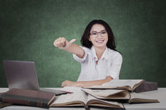 Schoolgirl with books and OK sign Stock Photography
