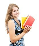 Schoolgirl with books over white Stock Images