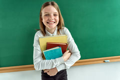 Schoolgirl with books Stock Images