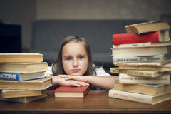 Schoolgirl and books Royalty Free Stock Photography