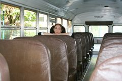 Schoolgirl in bus Royalty Free Stock Images
