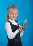 Schoolgirl with a calculator Stock Image