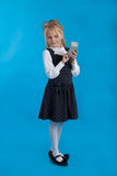 Schoolgirl with a calculator Royalty Free Stock Photography