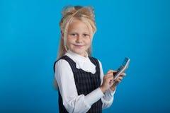 Schoolgirl with a calculator Stock Photos