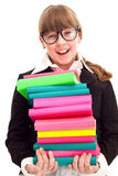 Schoolgirl carrying color stack books Stock Photography