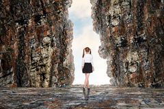 Schoolgirl in cave Royalty Free Stock Photography