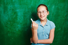 Schoolgirl with chalk Stock Photography