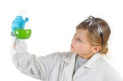 Schoolgirl in chemistry class Royalty Free Stock Image
