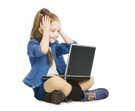 Schoolgirl child looking at computer. school girl. With notebook laptop, hand on head, isolated white background Stock Photography