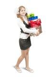 Schoolgirl with christmas gifts Stock Photos
