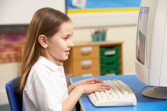 Schoolgirl In IT Class Using Computer Royalty Free Stock Image