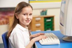 Schoolgirl In IT Class Using Computer stock images