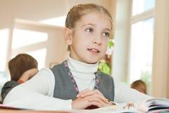 Schoolgirl in classroom Royalty Free Stock Images