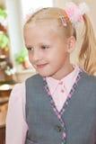 Schoolgirl in classroom Stock Image