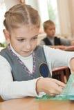 Schoolgirl in classroom Stock Images