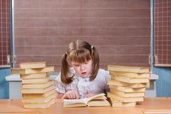 Schoolgirl in a classroom Stock Photo