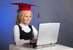 Schoolgirl at the computer Stock Images