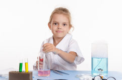 Schoolgirl conducts experiments in chemistry class Royalty Free Stock Images