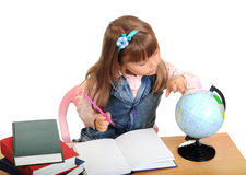 The schoolgirl considers the globe Stock Photos