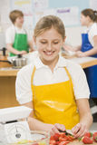 Schoolgirl in a cooking class Stock Images