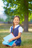 Schoolgirl with copybooks Royalty Free Stock Photography