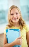 Schoolgirl with copybooks Stock Photo