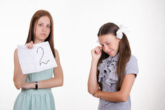 Schoolgirl crying because of two received Stock Photos