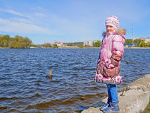 Schoolgirl on the dam in early spring Stock Photo