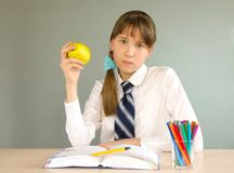 Schoolgirl at the desk Stock Photography