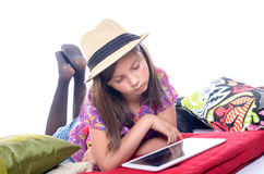Schoolgirl with a digital tablet Royalty Free Stock Photos
