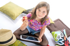 Schoolgirl with a digital tablet and fruit Stock Photo