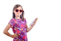 Schoolgirl with a digital tablet Stock Photos