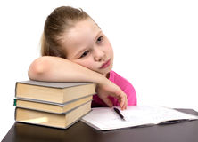 The schoolgirl does homework Stock Images