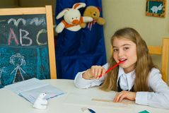 Schoolgirl does lessons Royalty Free Stock Image
