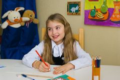 Schoolgirl does lessons Royalty Free Stock Photo