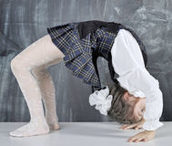 Schoolgirl doing gymnastics Stock Image