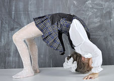 Schoolgirl doing gymnastics Stock Images