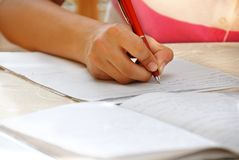 Schoolgirl doing her homework Royalty Free Stock Photos