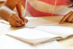 Free Schoolgirl Doing Her Homework Stock Image - 14438761