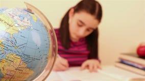 Schoolgirl doing her homework stock video