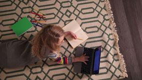Schoolgirl doing her homework at home. stock video footage