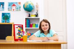 Schoolgirl doing homework Stock Image
