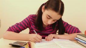 Schoolgirl doing homework stock video