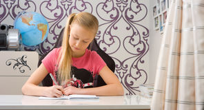 Schoolgirl doing homework after school Stock Photos