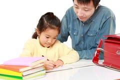Schoolgirl doing homework Royalty Free Stock Photo