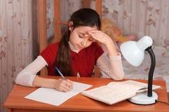Schoolgirl doing homework Royalty Free Stock Image