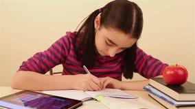 Schoolgirl doing homework using tablet pc stock footage