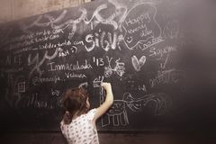 Schoolgirl drawing on a blackboard Stock Photos