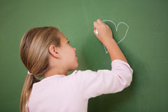 Schoolgirl drawing a heart Stock Photo